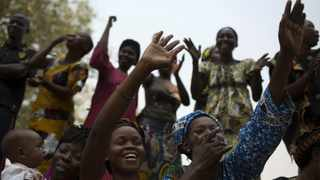 People react to a speech given by Alexandre-Ferdinand Nguendet, the head of Central African Republic's transitional assembly, at the Gendarmerie headquarters in Bangui on January 13, 2014. Picture: Siegfried Modola