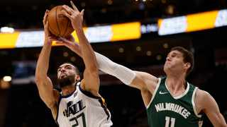 Rudy Gobert of the Utah Jazz grabs the rebound against Brook Lopez of the Milwaukee Bucks during their NBA game. Picture: Jeff Swinger/NBAE via Getty Images/AFP