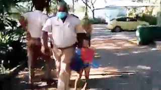 In screengrabs from a video that went viral on social media, KwaDukuza Municipality traffic police officers are seen grabbing a child from his father in a gated complex in Ballito after he allegedly walked on the beach. His father shouts at the officers to get their hands off the child and manages to wrestle him free of their grip before one of the officers handcuffs the father and walks him to the gate on Sunday.