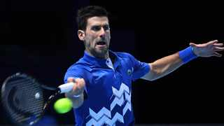 Novak Djokovic of Serbia in action against Alexander Zverev of Germany during their group stage match at the ATP Finals tennis tournament in London, Britain, 20 November 2020. Photo: EPA/Andy Rain