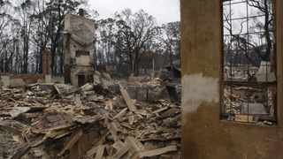 File photo: The remains of houses destroyed by bushfires are seen in the town of Heathcote Junction in Australia.