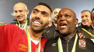 Al-Ahly's Hussein El Shahat and coach Pitso Mosimane celebrate after winning the CAF Champions League final against Zamalek. Picture: Khaled Elfiqi