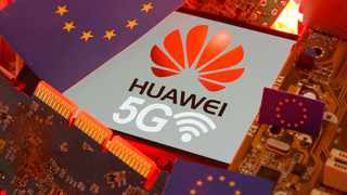 The EU flag and a smartphone with the Huawei and 5G network logo are seen on a PC motherboard. Picture: Reuters/Dado Ruvic/Illustration