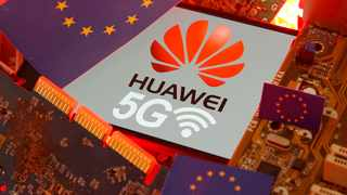 The EU flag and a smartphone with the Huawei and 5G network logo are seen on a PC motherboard. File picture: Reuters/Dado Ruvic