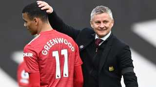 Manchester United manager Ole Gunnar Solskjaer gives Mason Greenwood a pat on the head after their Premier League match against Burnley. Picture: Gareth Copley/Reuters