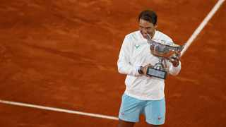 FILE - Spain's Rafael Nadal bites the Mousquetaires Cup (The Musketeers) as he celebrates winning the French Open. Photo: Thomas Samson/AFP