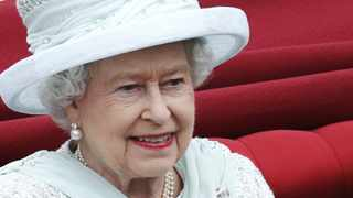 Britain's Queen Elizabeth smiles as she travels to Buckingham Palace during a procession to celebrate her diamond jubilee in London.