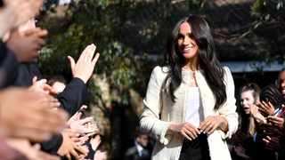 Meghan, Duchess of Sussex, smiles as she is welcomed by students to visit the Robert Clack School in Essex, Britain March 6, 2020, in support of International Women's Day. Picture: Ben Stansall/Pool via REUTERS