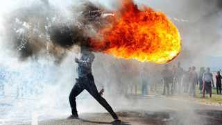 African News Agency photographer Phando Jikelo won the Top News category at the 3rd Andrei Stenin International Photo Contest for this picture of a protester at Ou Kaapse Weg in Grabouw. Picture: Phando Jikelo/African News Agency (ANA)