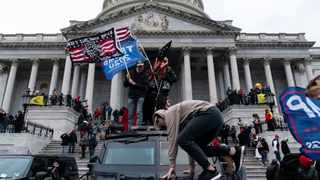 Supporters of US President Donald Trump protest outside the US Capitol on January 6, 2021. Photo by Alex Edelman/AFP