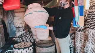 Tania de Vos, founder of Platform23, inspects reed baskets sourced from Zimbabwe. Picture: Supplied