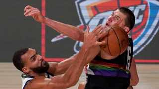 The Utah Jazz's Rudy Gobert and the Denver Nuggets' Nikola Jokic battle for the ball during their NBA playoff. Picture: Mark J. Terrill/AP