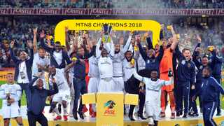 Cape Town City players and staff celebrate their MTN8 title win against Supersport United in Durban last night. Photo: Sydney Mahlangu/BackpagePix