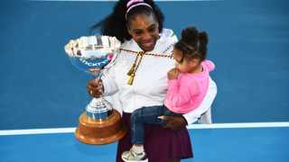 Serena Williams from the United States with daughter Alexis Olympia Ohanian Jr. and the ASB trophy after winning her singles finals match against compatriot Jessica Pegula at the ASB Classic in Auckland, New Zealand on Sunday. Photo: Chris Symes/AP