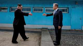 South Korean President Moon Jae-in and North Korean leader Kim Jong Un shake hands at the truce village of Panmunjom inside the demilitarized zone separating the two Koreas in April 2018. File picture: Korea Summit Press Pool via Reuters