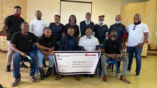 Representatives of the school governing body, student leadership, the principal, Wanderers Football Club, and the Vision39 leaders with the donation cheque. Picture: Supplied