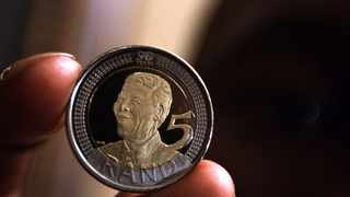 070708. David Mokgape holding a coin at the launch of the Nelson Mandela 90th birthday commemorative coin held at Nelson Mandela Foundation in Houghton. 373 Picture: Dumisani Sibeko