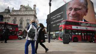 A screen with a picture and a message about Britain's Prince Philip, husband of Queen Elizabeth, is seen at Piccadilly Circus after he died at the age of 99, in London. Picture: Hannah McKay/Reuters