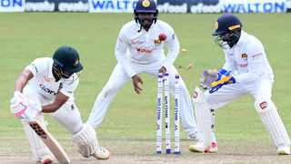 Bangladesh's Najmul Hossain Shanto is clean bowled as Sri Lanka's wicketkeeper Niroshan Dickwella and Dhananjaya de Silva watch during the fourth day of the second and final Test cricket match at the Pallekele International Cricket Stadium in Kandy on Sunday. Photo: Lakruwan Wanniarachchi/AFP
