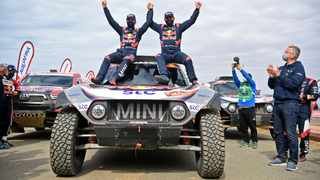 Stephane Peterhansel (right) celebrates with co-pilot Edouard Boulanger after their Dakar victory. Picture: Franck Fife / AFP.