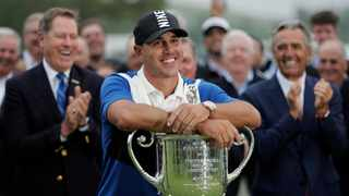 Brooks Koepka poses with the Wanamaker Trophy after winning the 2019 PGA Championship. Photo: Julio Cortez/AP Photo