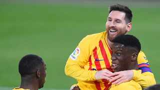 Barcelona's Ilaix Moriba (R) celebrates with Lionel Messi and and Ousmane Dembele. Photo: Ander Gillenea/AFP