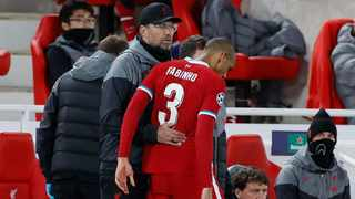 Liverpool's Fabinho is consoled by manager Jurgen Klopp after being substituted after sustaining a hamstring injury. Picture: Phil Noble/Reuters