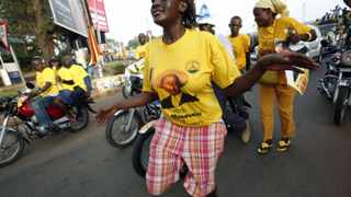 A supporter of Ugandan President Yoweri Museveni dances in the streets of Kampala to celebrate his victory in the election. President Jacob Zuma has offered his congratulations on behalf of South Africa.