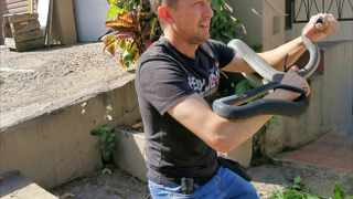 Durban snake catcher with the third black mamba he rescued from the same home in Verulam this month. Picture: Supplied