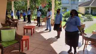 Staff lined up for morning roll call and sang songs of encouragement to tackle the day ahead. Picture: Supplied.