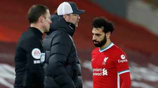 Liverpool's Mohamed Salah walks past manager Jurgen Klopp after being substituted during their Premier League game against Chelsea at Anfield on Thursday. Photo: Phil Noble/Reuters