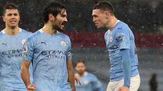 Manchester City's Ilkay Gundogan celebrates with Phil Foden after scoring their second goal in their Premier League game against Aston Villa at The Etihad Stadium in Manchester on Wednesday. Photo: Martin Rickett/Reuters