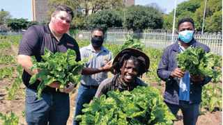 ELANGENI Green Zone team members Lungelo Mdladla and Sandile Mthembu with Boxer's Deon Wessels, left, and Joshua Ponsami in the vegetable garden.