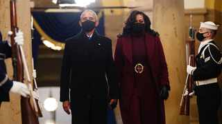 Former U.S. President Barack Obama and Michelle Obama arrive in the Crypt of the U.S. Capitol for President Joe Biden's inauguration ceremony. Picture: Jim Lo Scalzo/Pool via REUTERS