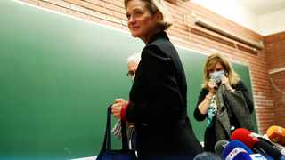 Belgium's artist and sculptor Delphine Boel leaves after a press conference in Brussels. Picture: Francisco Seco/AP