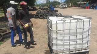 A view of reusable water storage containers for sale in Makokoba, a poor neighbourhood of Bulawayo, Zimbabwe. File picture: Lungelo Ndhlovu/Thomson Reuters Foundation