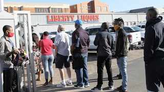 Queues outside Durban's Liberty Liquors on the day the first booze ban was lifted in June last year.