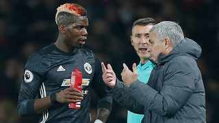 FILE - Manchester United's manager Jose Mourinho (R) talks with midfielder Paul Pogba during an English Premier League match. Photo: Ian Kington/AFP