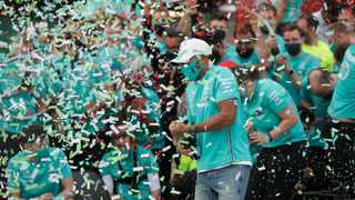 Race winner Lewis Hamilton as the Mercedes team celebrate winning the constructors championships. Photo: Luca Bruno/Reuters