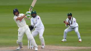 England's Jos Buttler plays a shot during the fourth day of the first cricket Test match against Pakistan at Old Trafford in Manchester on Saturday. Photo: Lee Smith/AP