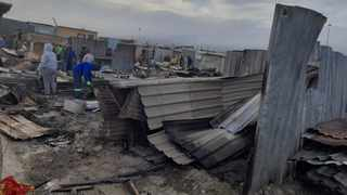 A fire that broke out in the early hours of yesterday morning in Nomzamo, Strand, has left up to 126 families destitute. Community leaders are appealing for donations and assistance, the most of the residents are unemployed. Picture: Supplied