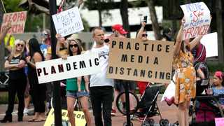 """Protesters demanding Florida businesses and government reopen, march in downtown Orlando. At the onset of the coronavirus pandemic """"anti-vaxxers"""" had doubts about the origin and nature of the virus itself. File picture: John Raoux/AP"""