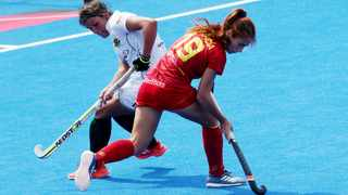 Spain's Begona Garcia (right) in action against South Africa's Kara-Lee Botes (left) during the women's Field Hockey World Cup match. Photo: Sean Dempsey/EPA