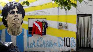 A graffiti of soccer legend Diego Armando Maradona is seen outside the house where he spent his childhood, in Villa Fiorito, outskirts of Buenos Aires, Argentina on Friday. Photo: Ricardo Moraes/Reuters