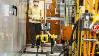 Fluffy's handler Paula Wiebelhaus navigates the dog-like robot through tough-to-reach areas within the plant. Picture: Ford.