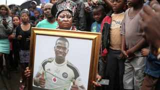 ORLANDO Pirates supporter Joice with the Senzo Meyiwa's picture as his biggest fan and friend. Picture: Bongani Mbatha/African News Agency/ANA