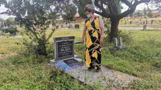 Sandra Cyster at the grave of her father and a couple unknown to the family at Eersterust Cemetery. Picture: Goitsemang Tlhabye