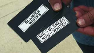 At the Apartheid musuem in Johannesburg entrance cards marked 'whites' and ' non-whites' are issued at random and not according to race on payment for use at the segregated entrance to illustrate being separated. Picture: John Hogg