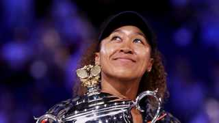 Naomi Osaka celebrates with the trophy after winning her final match against Jennifer Brady. Photo: Loren Elliott/Reuters