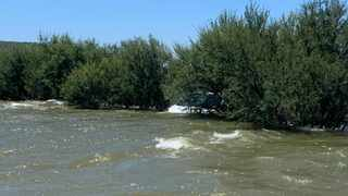 A motorist was saved after his vehicle was swept away in a strong river current. Photo: SAPS